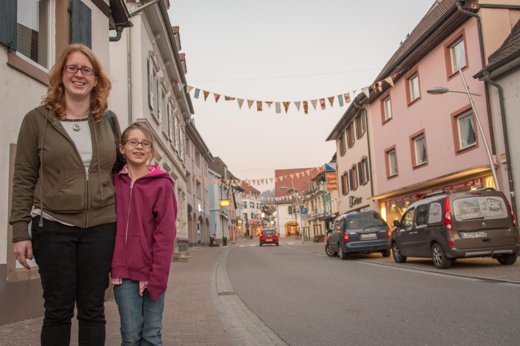 Miranda and Phoenix along the main street in Kandern, in the early evening. Many of the streets/buildings look like this, and above many shops are apartments.