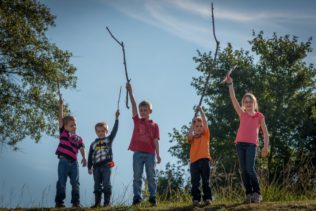 Sticks are awesome. Especially when the littlest kids have the biggest ones. We were very happy at the top of the hill.