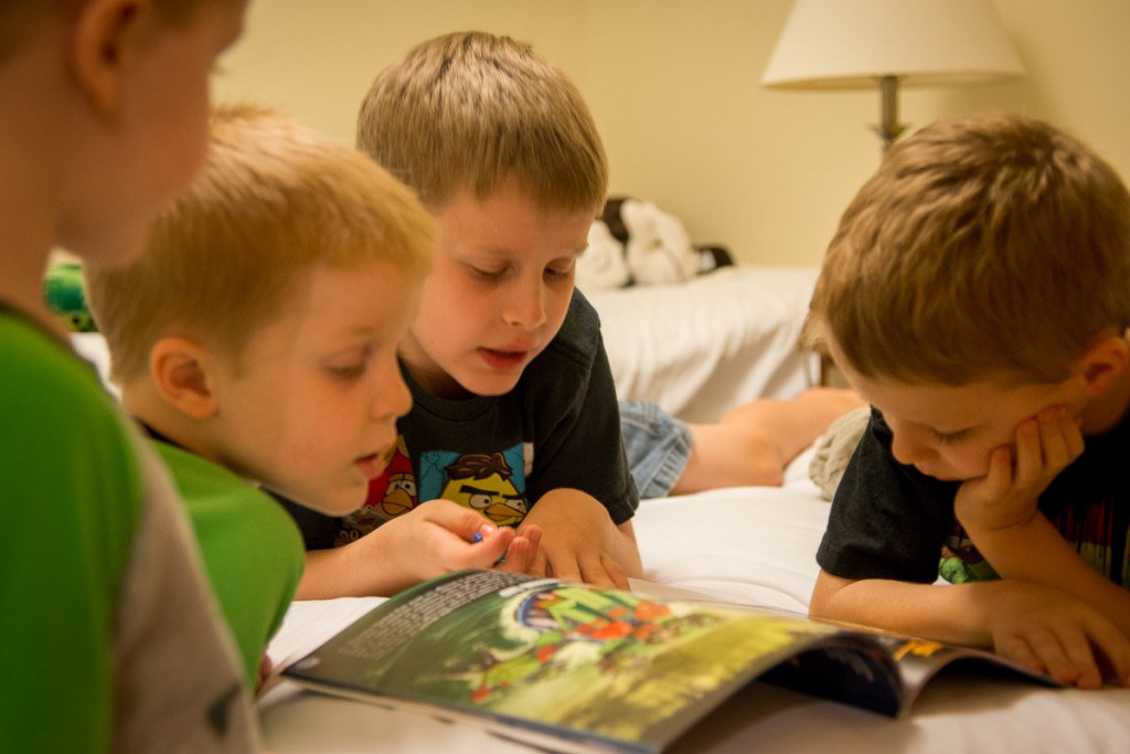 Cyclops reads to the other boys. Nevermind he's reading a book about all the characters in the Ninjago world--he's being nice to all three of them at the same time--that's a win!