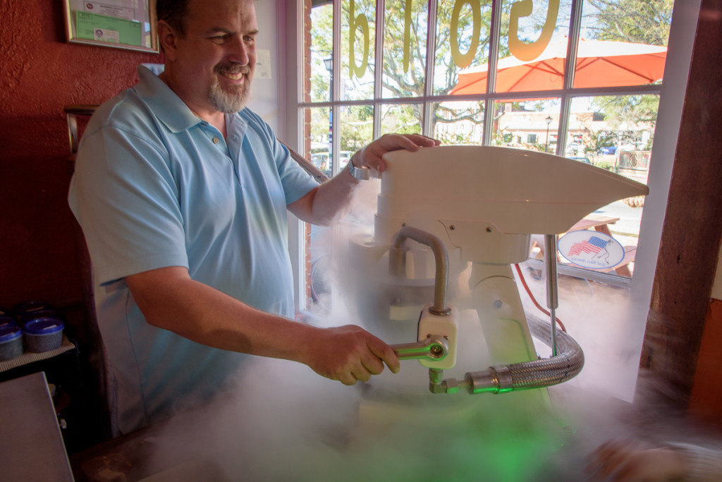 The proprietors at Frozen Gold (right next door to the BBQ joint, of course) take their frozen treats very seriously. Here the owner turns cream, sugar, and strawberries into something tasty.