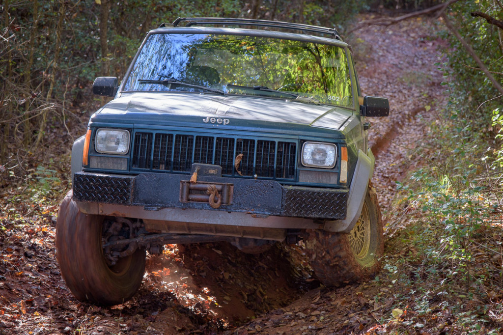 We drove the '96 Jeep Cherokee on both courses today. On this part of the second course, the washed-out section shifts from left to right, as we bounce through.
